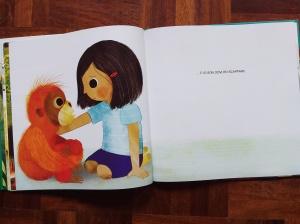 Bambina e orango